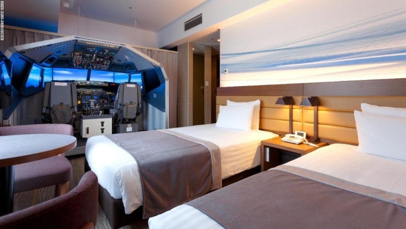 This Hotel Room Has A Full Sized Boeing 737 Flight Simulator.